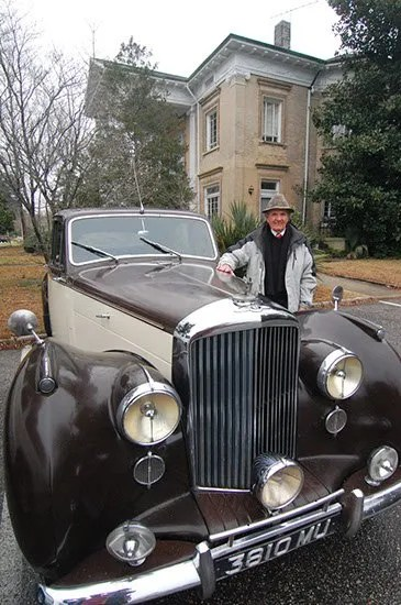 Kinney with his vintage '54 Bentley with the Bennettesville newspaper office in the background.
