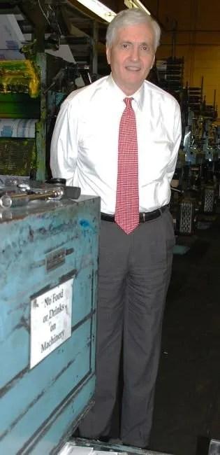 Scott had printer's ink in his veins. Here he is with the Aiken Standard's press in 2013.