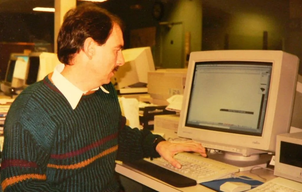 Harter working on his computer at the Times and Democrat newsroom.