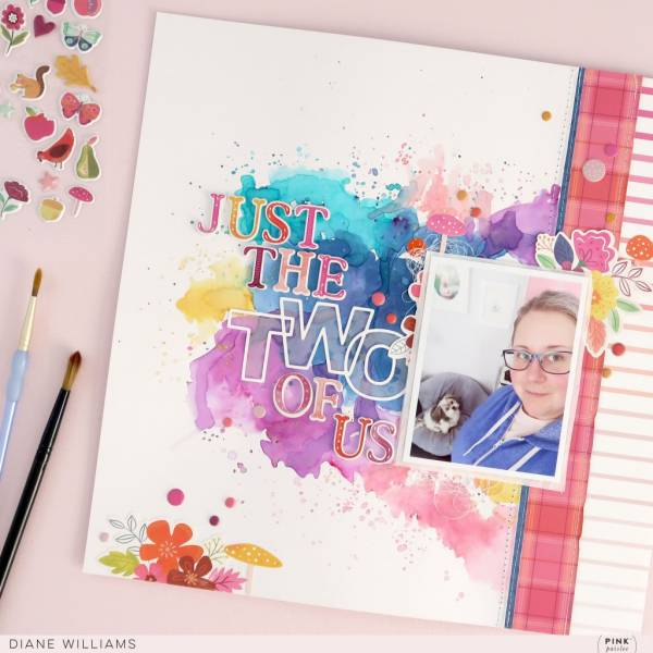 I love the bold splashes of watercolor on the background of this layout from Diane.