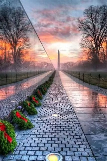 Vietnam Memorial Wall at Sunrise, showing a reflection of the Washington Monument