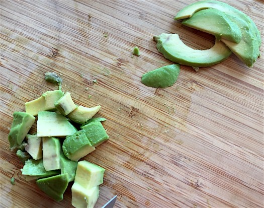 diced and sliced avocado on cutting board