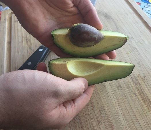 Separating avocado quarters from the pit