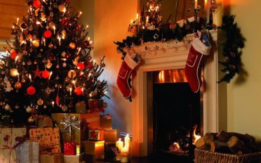 traditional-christmas-decorations-family-room-white-fireplace-christmas-decor-floral-shelf-garland-ideas-red-stocking-shelf-for-christmas-big-christmas-tree-ideas-christmas-red-ball-lamp
