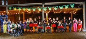 Group photos of Screech performers lined up on stage