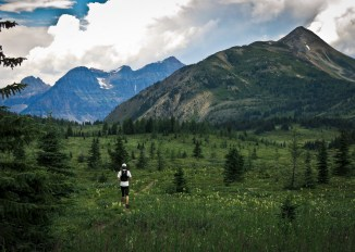 Jogging through a lush meadow toward our last climb up Quartz Ridge on right.