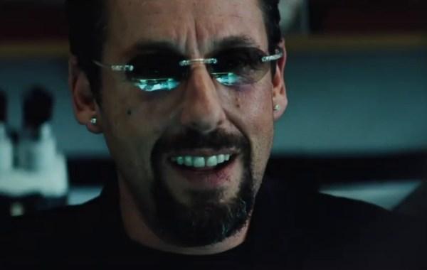 closeup of man's face wearing sunglasses, beard