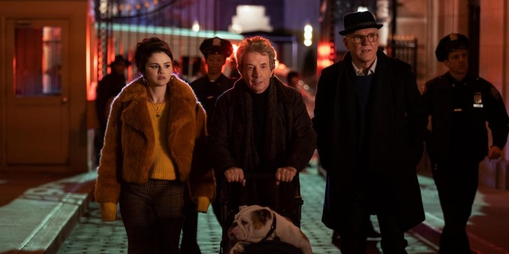 """Only Murders In The Building -- Episode 101 -- From the minds of Steve Martin, Dan Fogelman and John Hoffman comes a comedic murder-mystery series for the ages. """"Only Murders In The Building"""" follows three strangers (Steve Martin, Martin Short and Selena Gomez) who share an obsession with true crime and suddenly find themselves wrapped up in one. When a grisly death occurs inside their exclusive Upper West Side apartment building, the trio suspects murder and employs their precise knowledge of true crime to investigate the truth. As they record a podcast of their own to document the case, the three unravel the complex secrets of the building which stretch back years. Perhaps even more explosive are the lies they tell one another. Soon, the endangered trio comes to realize a killer might be living amongst them as they race to decipher the mounting clues before it's too late. Mabel (Selena Gomez), Oliver (Martin Short), and Charles (Steve Martin), shown. (Photo by: Craig Blankenhorn/Hulu)"""