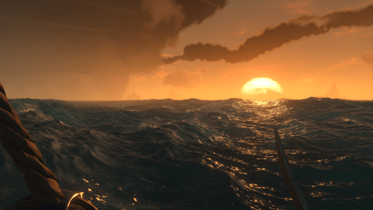 Sunset over the ocean in Sea of Thieves