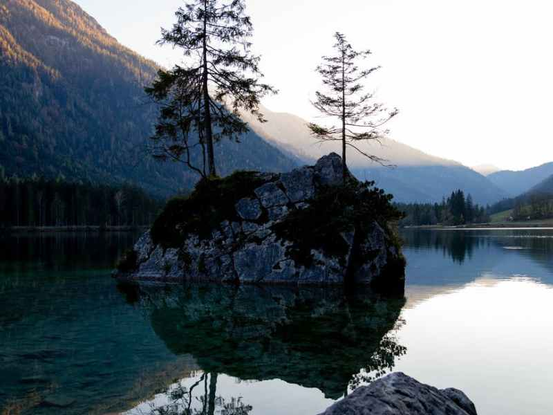 photo of rocks in the middle of lake