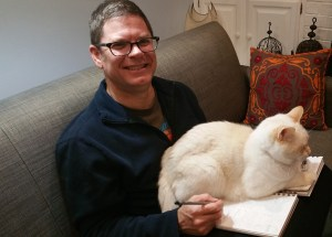 David Borden trying to work on a comic book but his cat is sitting on it Oh, and he is definitely a shy introverted misfit