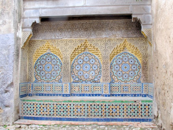 One of the most beautiful sights in Tangiers: a public fountain in the Kasbah with Islamic tiles, exquisite plasterwork and carved wooden roof .