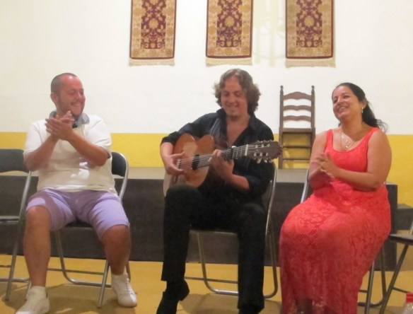 "Jeromo sings in the ""fin de fiesta"" jam session, with guitarist Luis and co-owner Maria."