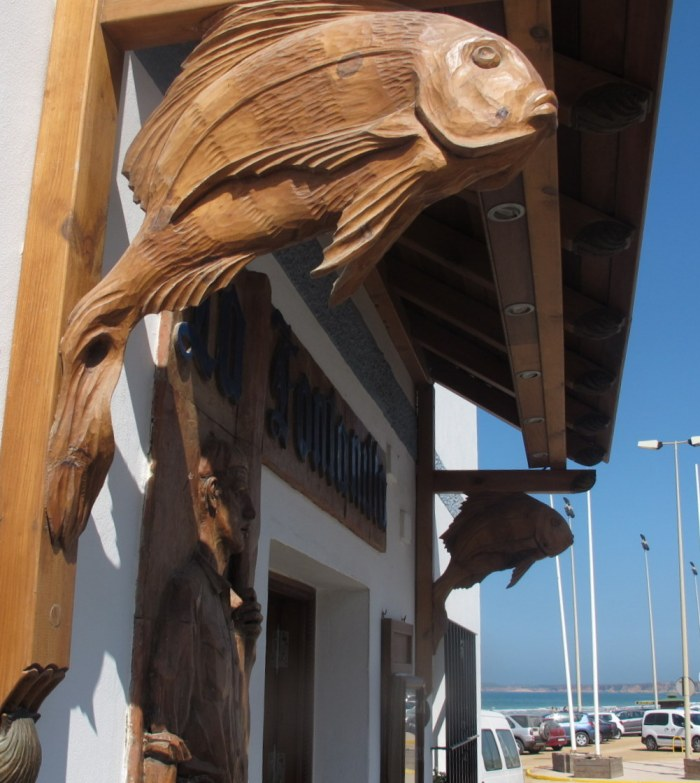 Beautiful wood carvings at the entrance of La Fontanilla fish restaurant in Conil.