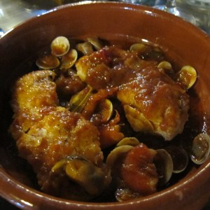 Hake with prawns and clams in a tomato sauce.