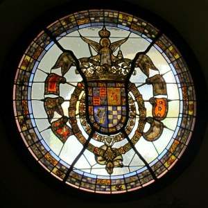 Stained glass window with Casa de Alba coat of arms - the bottom right part is used as their logo.