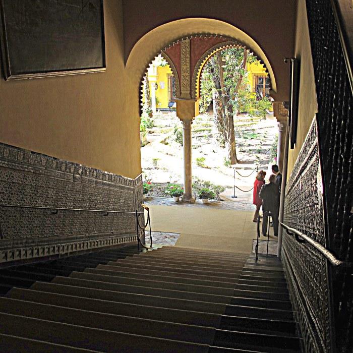 Grand tiled staircase, looking onto the main patio.