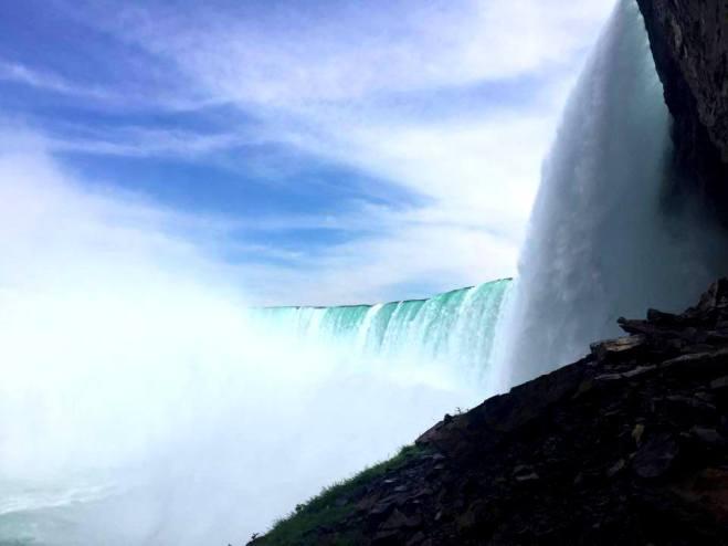 behind the falls three