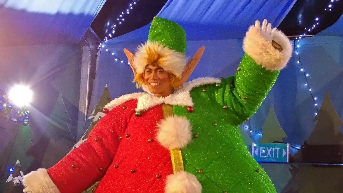 Jovial dancing elf in Santa's Village.