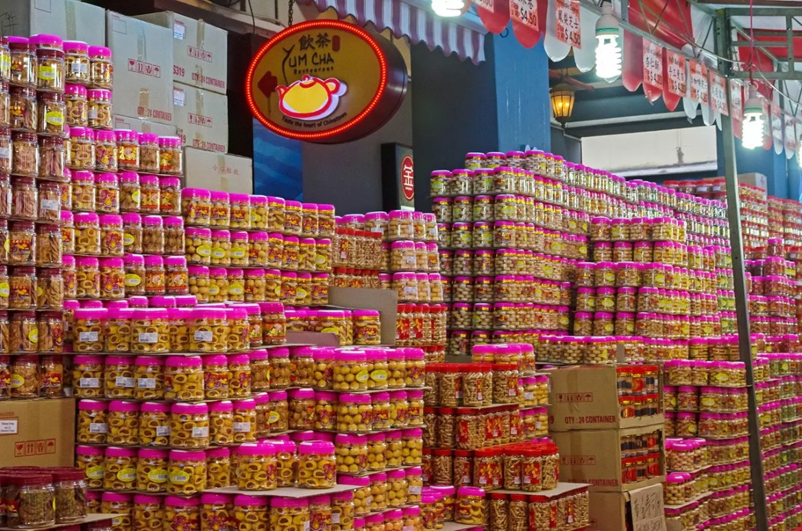 Mountains of Chinese New Year snacks on sale in the Chinatown festive bazaar.