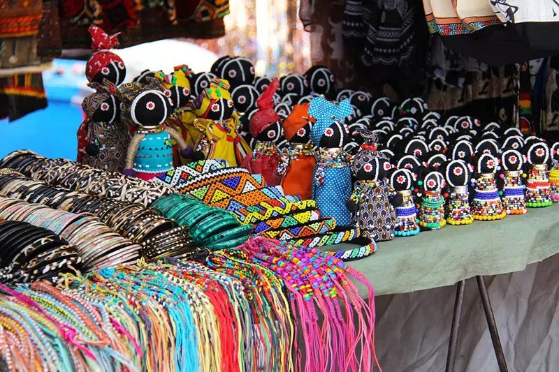Art and craft items for sale in an African marketplace.