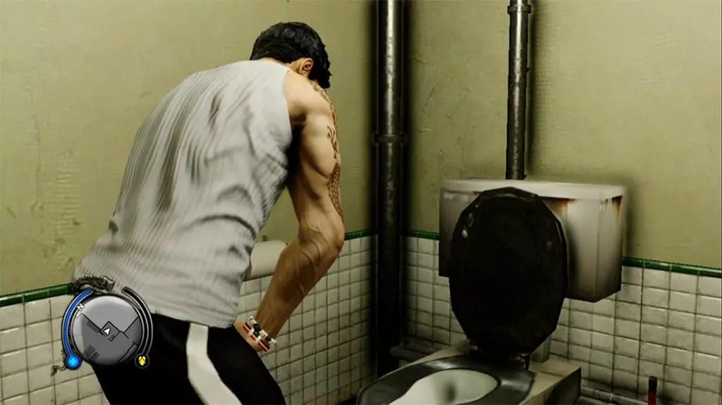 Wei Shen using the toilet.