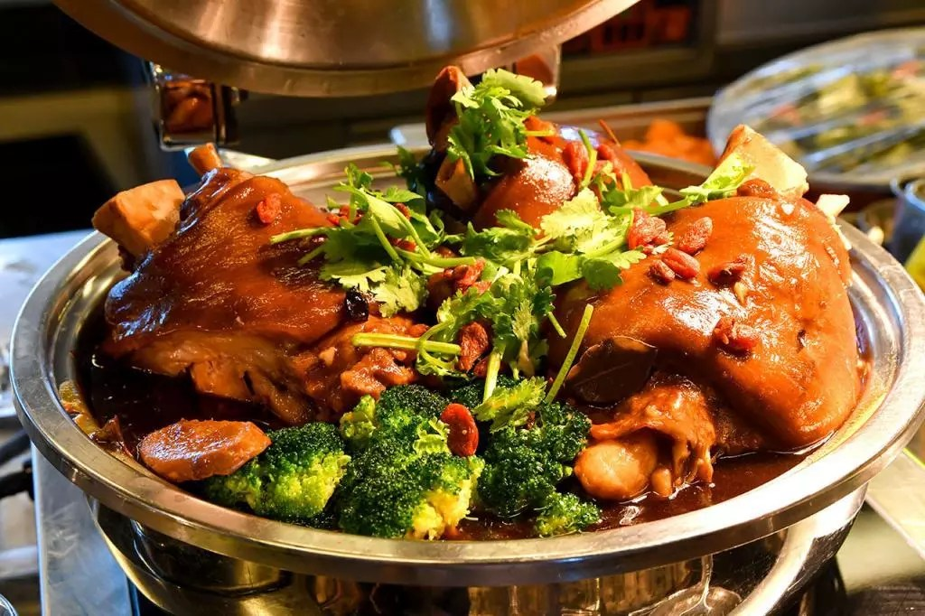 Pork knuckle cooked in chestnut sauce.
