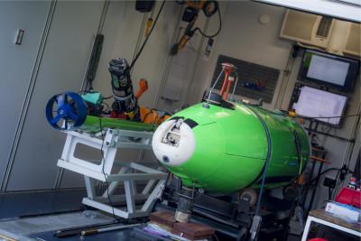 Two AUVs onboard a research vessel