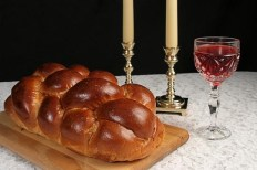 Traditionally, challah is eaten at Shabbat. Other traditional parts of a Shabbat meal include candles and a glass of wine.