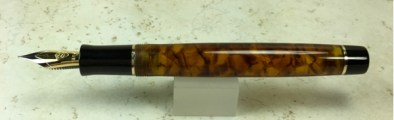 Exemplar in Illuminated Amber Tortoise with Bronze trim - Small