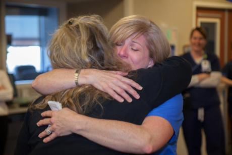 Kuehn embraces Terrie Dagenhart, one of the primary nurses who cared for her and stayed in touch after being discharged from Baylor Plano.