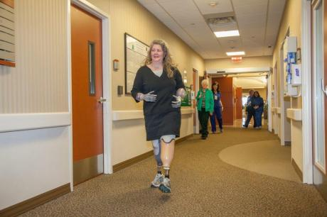 Kathryn Kuehn walks through hallway at Baylor Plano.