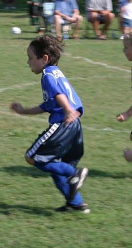 Daniel playing soccer as a child