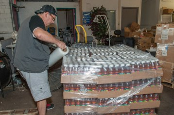 Hundreds of bottle of apple juice are palletized before being shipped to Syrian refugees.