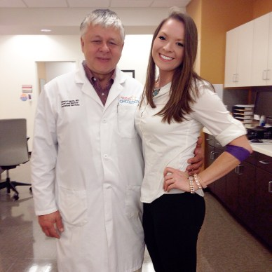 Dr. Edward Agura smiles next to his patient, Candice Stinnett.