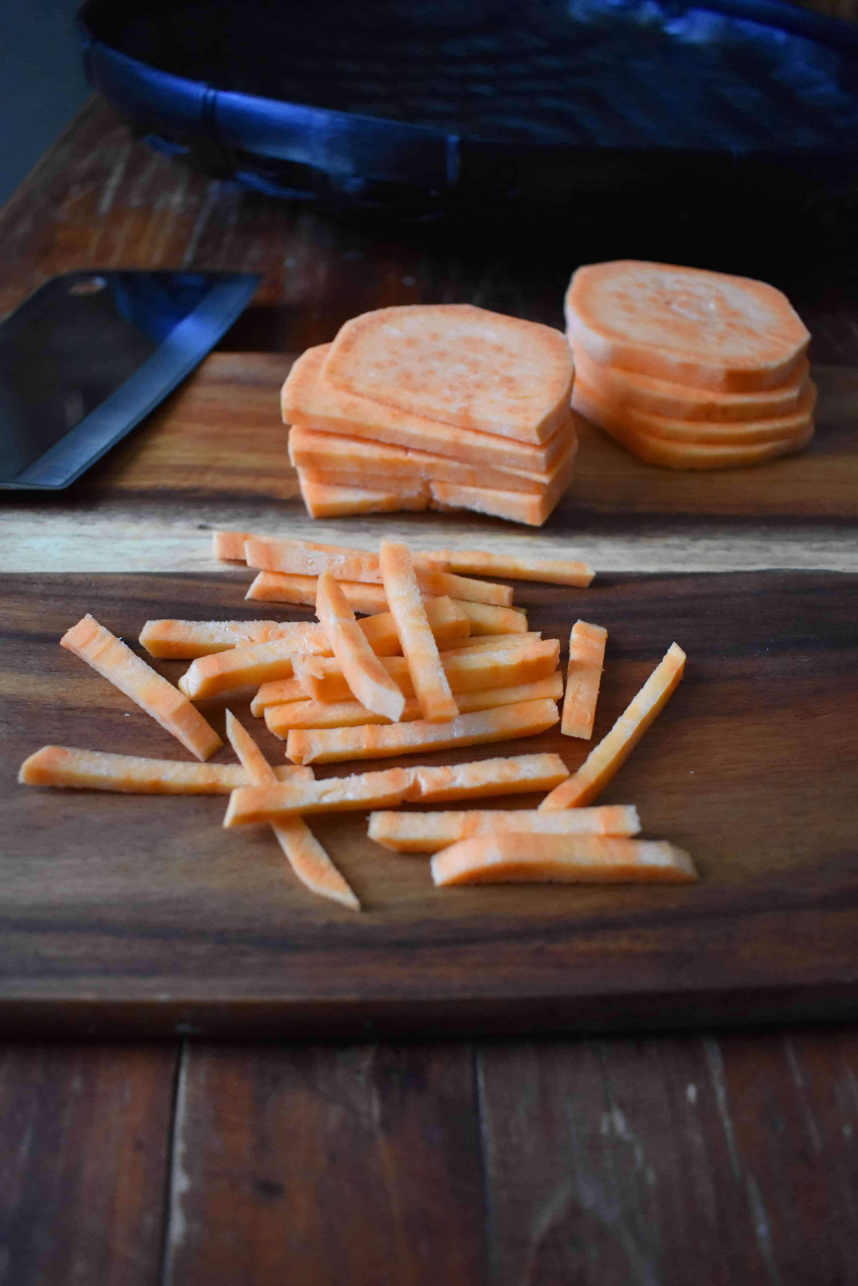 Cutting sweet potato into thin strips.