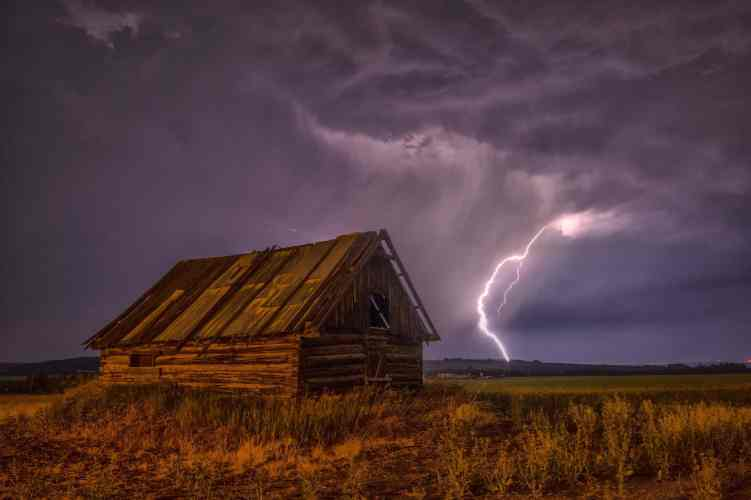 Lightening storm over an old barn