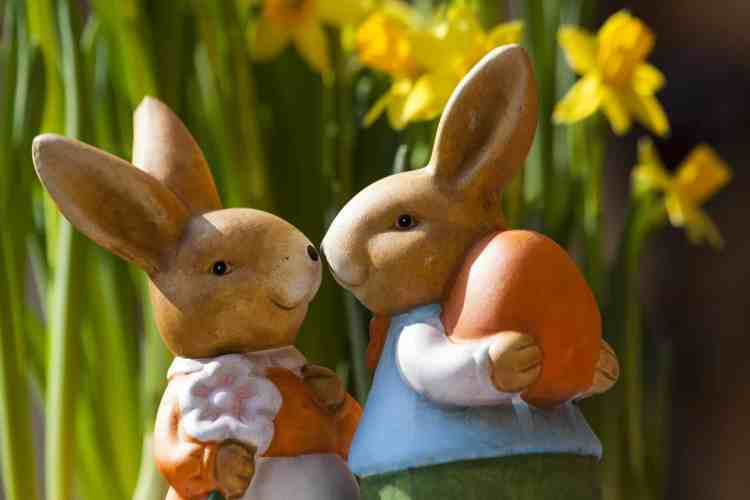 Porcelain Rabbits Holding Easter Egg