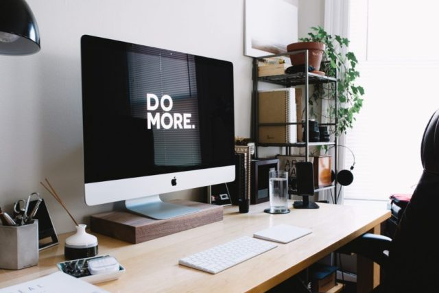 An iMac on a desk with the words