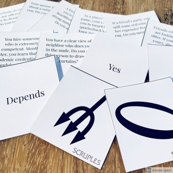 question, anser and voting cards on a table