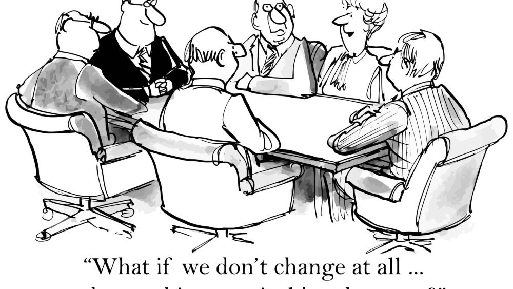 """business people meet in conference room, caption reads """"What if we don't change at all and something magical happens?"""""""