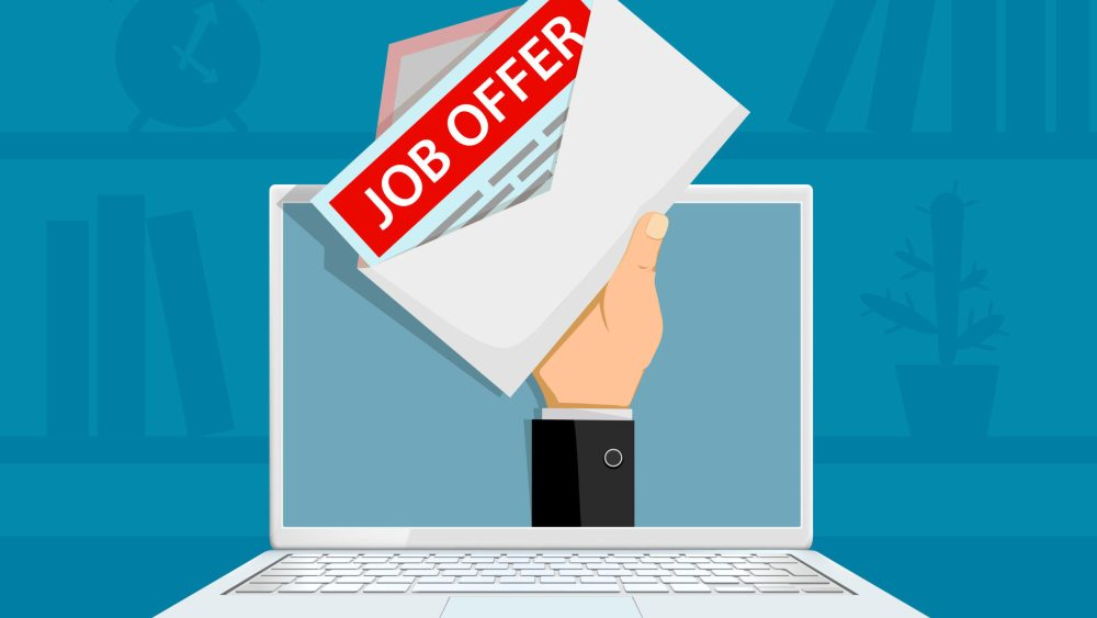 hand comes through computer screen to deliver job offer