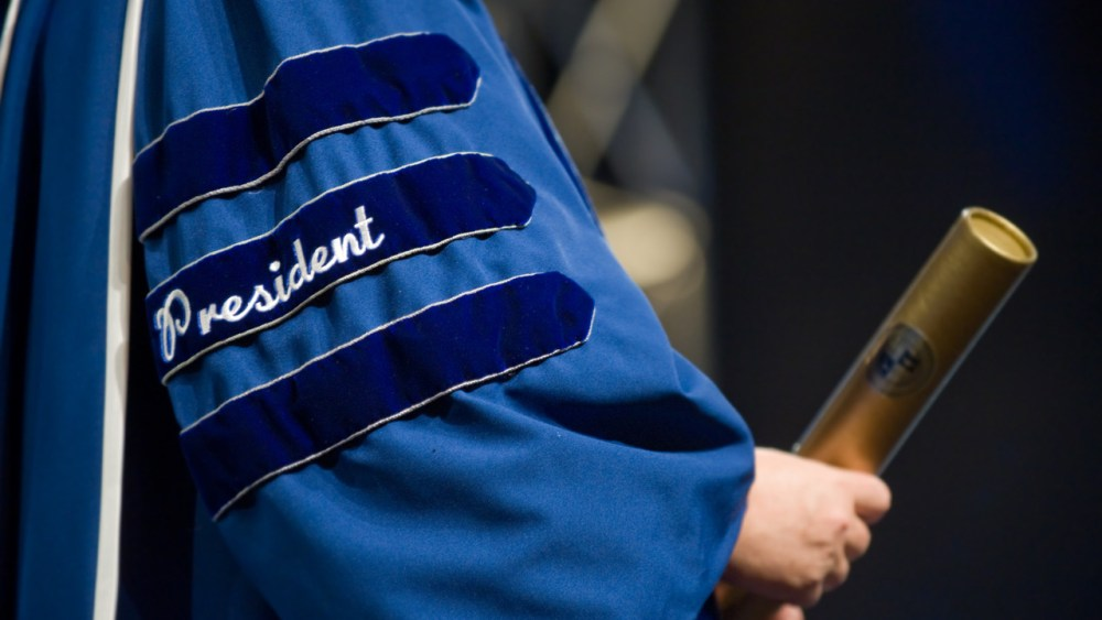 college president hands out diploma