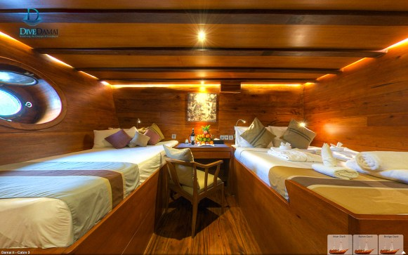 Downstairs cabins offer both a double or queen bed and a daybed. (Courtesy Damai II)