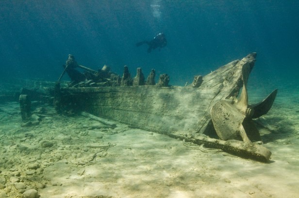 A diver swims over the wreck of Monohansett. (Photo credit: Tane Casserley/NOAA)