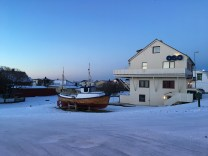 The harbor at Andenes glows in the light of sunrise on our third day. (Photo by Rebecca Strauss)