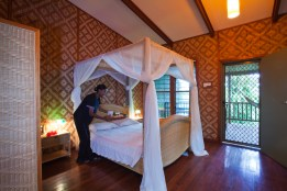 Tufi's deluxe bungalows feature four-poster beds, oceanfront decks and artfully thatched walls. (Image courtesy of Tufi Dive Resort)