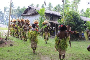 Traditional dancers greet guests from Tufi on an organized village visit. (Photo credit: Emmanuel Sapina)