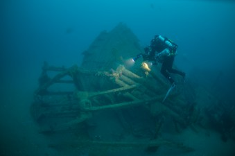 A NOAA diver inspects and documents the steering quadrant. Photo: Joe Hoyt, NOAA