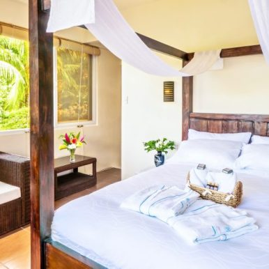 Rooms and suites are available with sea and garden views. (Courtesy Edgewater Dive and Spa Resort)